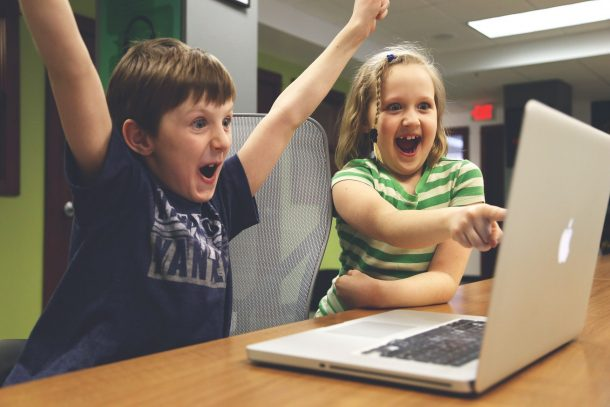 happy children at computer